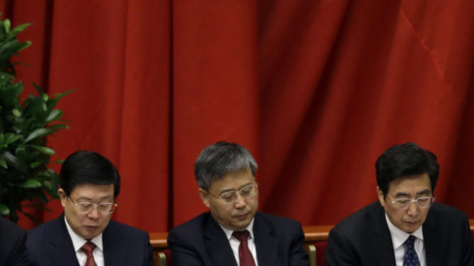 Chinese Public Security Minister Meng Jianzhu, center, rubs his eyes during the opening session of the 18th Communist Party Congress at the Great Hall of the People in Beijing Thursday, Nov. 8, 2012. The week-long congress starts a carefully choreographed but still fraught power transfer in which President Hu Jintao and most of the senior leadership will begin to relinquish office to a new slate of leaders for the coming decade headed by the appointed heir, Vice President Xi Jinping. (AP Photo/Ng Han Guan)