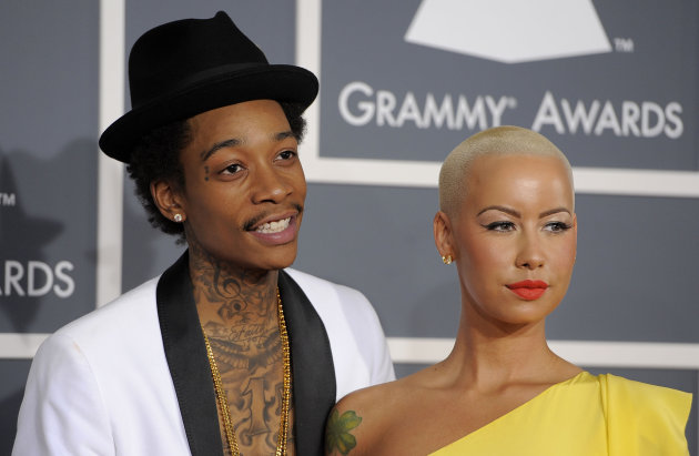 FILE - This Feb. 12, 2012 file photo shows Wiz Khalifa, left, and Amber Rose at the 54th annual Grammy Awards in Los Angeles. Khalifa says the preparation of becoming a first-time father and husband has helped put him in a more mature musical state of mind. &quot;I&#39;m at a different point of my life,&quot; said Khalifa, whose sophomore album, &quot;O.N.I.F.C.,&quot; debuted at No. 2 on Billboard&#39;s 200 albums chart Wednesday with more than 141,000 copies sold, according to Nielsen Scan. (AP Photo/Chris Pizzello, file)