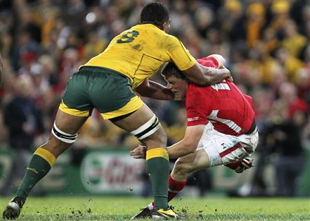 Australia's Palu tackles Wales' Priestland during their international rugby union test match in Brisbane
