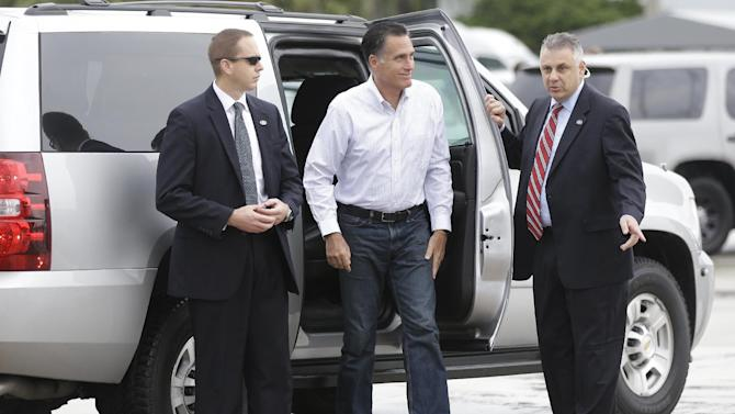 Republican presidential candidate and former Massachusetts Gov. Mitt Romney gets out of his vehicle before boarding his campaign plane in West Palm Beach, Fla., Friday, Sept. 21, 2012. (AP Photo/Charles Dharapak)