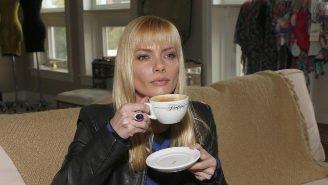 Jaime Pressly has a cup of coffee wearing a RVN Dress and a YoYo Yeung Jacket and a Tivon Fine Jewellery Ring on Tuesday December 4, 2012 in Los Angeles, California. (Photo by Todd Williamson/Invision/AP Images)
