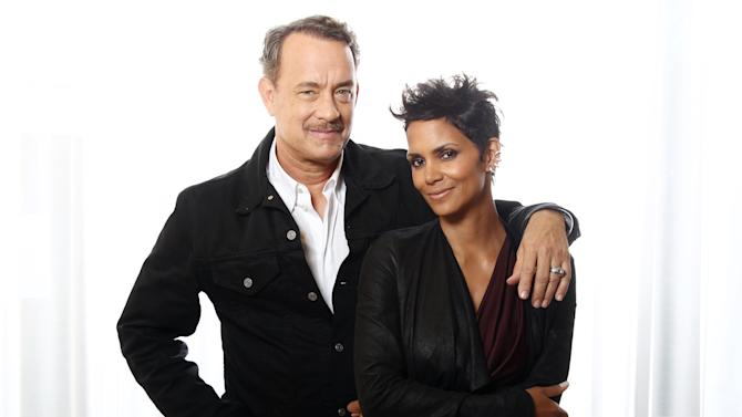 "In this Oct. 14, 2012 photo, actors Tom Hanks, left, and Halle Berry, from the upcoming film ""Cloud Atlas,"" pose for a portrait in Beverly Hills, Calif. The stars of ""Cloud Atlas,"" along with British author David Mitchell, who wrote the novel that inspired the genre-bending epic about souls returning and intertwining over the centuries, shared their beliefs and disbeliefs about reincarnation as the film heads to U.S. theaters Oct. 26, 2012. Hanks himself doesn't buy into reincarnation, while Berry, Whishaw, Mitchell, Sarandon and co-stars Hugo Weaving and Jim Sturgess either believe or at least think it's possible that souls come back for an encore. (Photo by Matt Sayles/Invision/AP))"