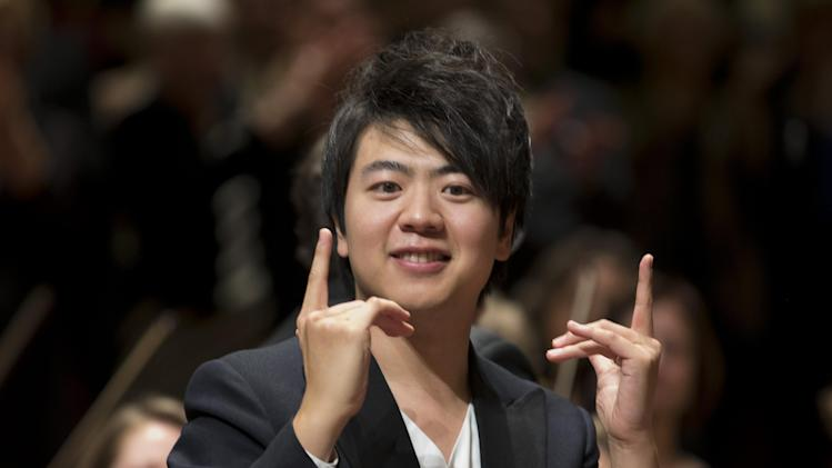 FILE- In an April 10, 2013 file photo, Chinese pianist Lang Lang gestures after performing in a concert marking the 125th anniversary of the Royal Concert Hall Orchestra in Amsterdam, Netherlands. Lang Lang joins the Detroit Symphony Orchestra at its home but has agreed to share his music live with the world. The orchestra plans to announce Friday, Sept. 6, 2013 that the Sept. 29 Orchestra Hall concert marks Lang's first live webcast with a U.S. orchestra. The one-night performance will be viewable on the orchestra's website and a free mobile app. (AP Photo/Peter Dejong, FILE)