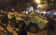 Protesters opposing Egyptian President Mohamed Mursi gather near a military tank as they take part in a march despite a nighttime curfew in the city of Suez in this January 28, 2013 file picture. To match Insight EGYPT-ARMY REUTERS/Stringer/Files (EGYPT - Tags: POLITICS CIVIL UNREST MILITARY) -