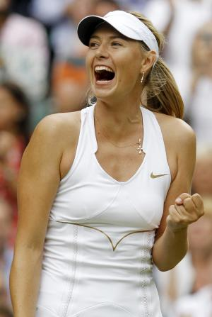 Russia's Maria Sharapova celebrates defeating Germany's Sabine Lisicki in their semifinal match at the All England Lawn Tennis Championships at Wimbledon, Thursday, June 30, 2011. (AP Photo/Anja Niedringhaus)