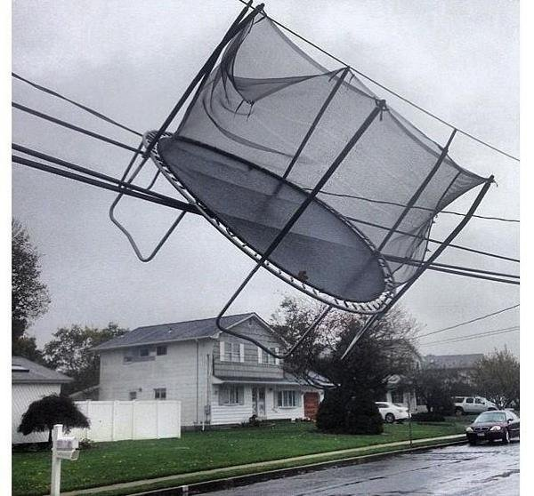 Click the photo to go to a slideshow of reader photos of Sandy. Here, the superstorm entangled a trampoline in Connecticut power lines. (Photo credit: Derek Oxley)