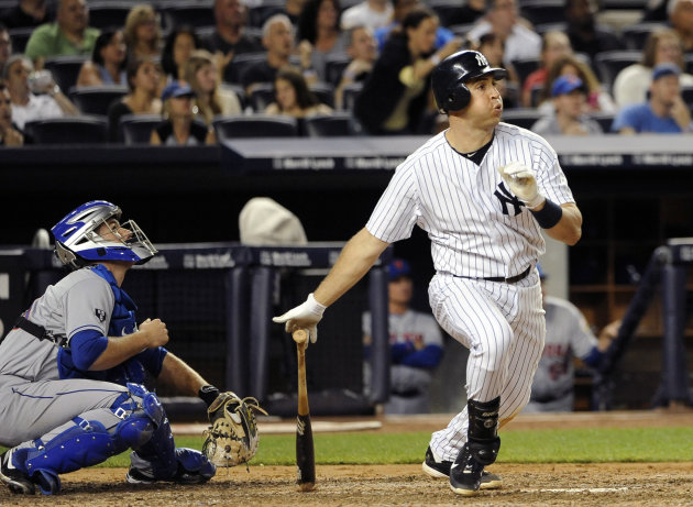 New York Mets catcher Josh Thole, left, watches as New York Yankees' Mark Teixeira, right, hits a two-run home run off Mets starting pitcher Dillon Gee in the sixth inning of an interleague baseball g