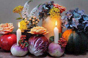 We kind of want to use these all year round! Simply core a whole bunch of vegetables and fill them with flowers, candlesticks, and tea lights. Be sure to save the stuff you carve out and roast up some veggies!