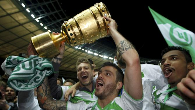 VfL Wolfsburg's Vieirinha holds up trophy as he celebrates winning German Cup final soccer match against Borussia Dortmund in Berlin