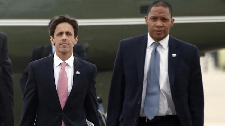 FILE - This Oct. 30, 2013, file photo shows David Simas, President Barack Obama's political director, left, and Rob Nabors, Deputy Chief of Staff as they accompany the president to board Air Force One at Andrews Air Force Base, Md. The White House is opposing congressional Republicans' subpoena to Simas to testify on Capitol Hill this week. White House counsel Neil Eggleston said in a letter that the House Oversight Committee's demand that Simas testify threatens the president's independence and ability to get candid advice to carry out his constitutional duties. (AP Photo/Charles Dharapak, File)