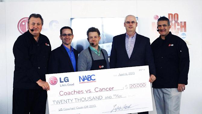 IMAGE DISTRIBUTED FOR LG -  In this photo released on Monday April 8, 2013, Chef Richard Blais, center, and Howard Goodrow, second from right, join James Fishler, second left, senior vice president of marketing for LG Electronics USA, as he presents a donation of 20,000 to Coaches vs. Cancer in the name of Bob Huggins, left, head coach of the West Virgins University men's basketball team,  during the LG Coaches' Cook-off NCAA Final Four weekend in Atlanta.  Huggins competed against Frank Martin, right, University of South Carolina head coach. ( Photo by Wilford A Harewood/Invision for LG/AP Images)