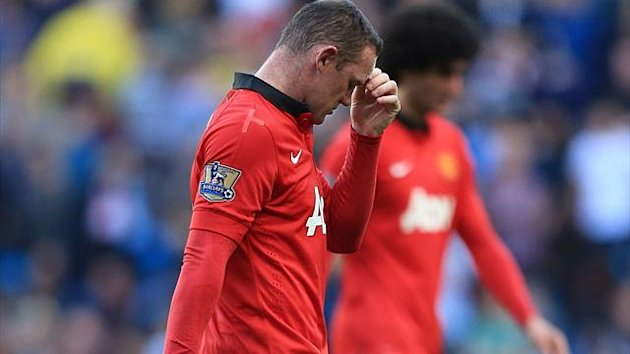 Manchester United's Wayne Rooney leaves the field at half-time (PA Photos)