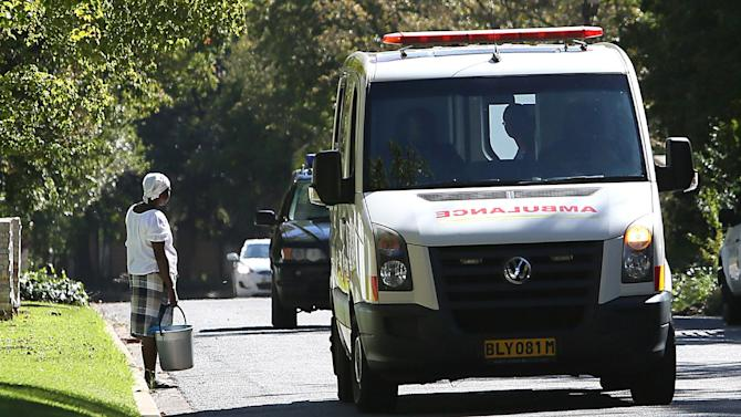 An ambulance drives down a road in Johannesburg on April 6, 2013