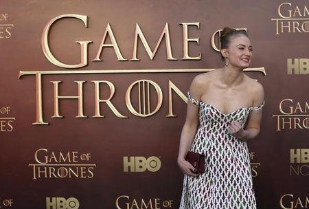 "Actress Sophie Turner gestures while arriving for the season premiere of HBO's ""Game of Thrones"" in San Francisco"