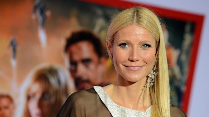 """Actress Gwyneth Paltrow arrives at the world premiere of Marvel's """"Iron Man 3"""" at the El Capitan Theatre on Wednesday, April 24, 2013, in Los Angeles. (Photo by Jordan Strauss/Invision/AP)"""