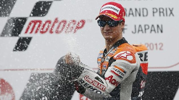 Honda MotoGP rider Dani Pedrosa of Spain sprays champagne as he celebrates on the podium after winning the Japanese MotoGP