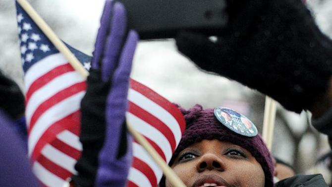 Siobhan Palmore uses her phone to take a photo in the crowd on the National Mall during the inauguration events in Washington, D.C., Jan. 21, 2013.  (AP Photo/Parker Michels-Boyce, The News & Advance)