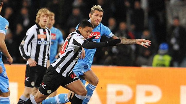 Udinese's defender of Colombia Muriel Fruto Luis Fernando (L) runs with the ball in front of Swiss Napoli's midfielder Valon Behrami (R) during their Serie A football match at Friuli Stadium in Udine (AFP)