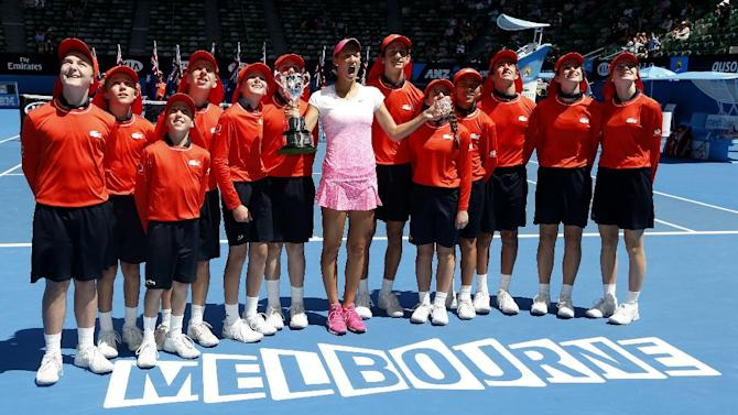 Tereza Mihalikova of Slovakia, center,  holds the trophy wit ball kids after winning over Katie Swan of Britain in the junior girls' singles final at the Australian Open tennis championship in Melbourne, Australia, Saturday, Jan. 31, 2015. (AP Photo/Vincent Thian)