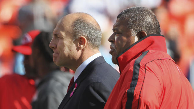 Kansas City Chiefs general manager Scott Pioli, left, and coach Romeo Crennel watch warmups before an NFL football game against the Carolina Panthers at Arrowhead Stadium in Kansas City, Mo., Sunday, Dec. 2, 2012. (AP Photo/Colin E. Braley)