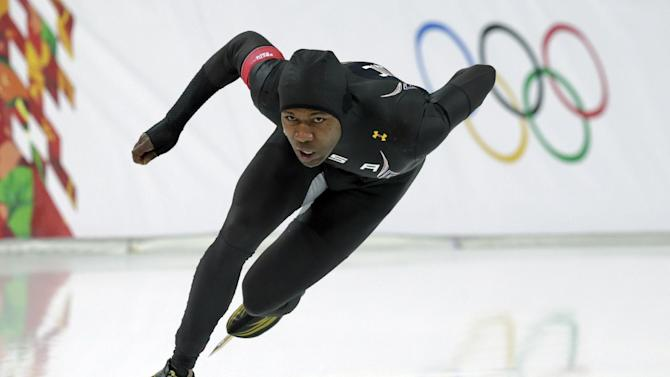 Shani Davis of the U.S. competes in the men's 1,000-meter speedskating race at the Adler Arena Skating Center during the 2014 Winter Olympics in Sochi, Russia, Wednesday, Feb. 12, 2014