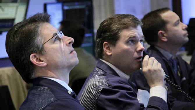 Traders work on the floor at the New York Stock Exchange in New York, Tuesday, March 6, 2012. Stocks in the U.S. are down more than 1 percent at the opening bell, following similar declines in Europe. (AP Photo/Seth Wenig)