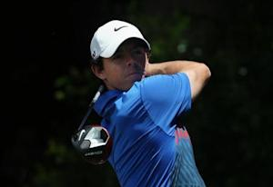 Northern Ireland's McIlroy hits a shot on the seventh hole during the fourth round of the Australian Open golf tournament at Royal Sydney Golf Club