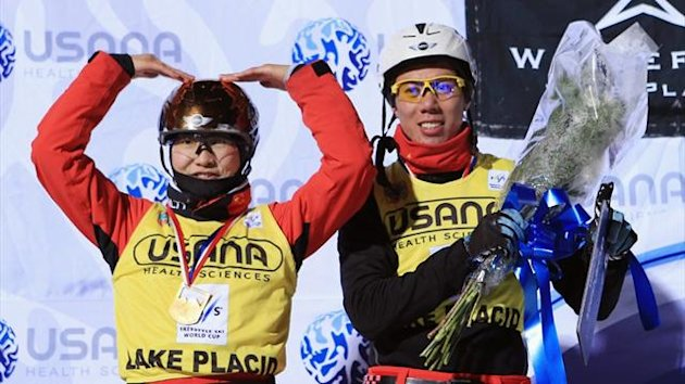 Xu Mengtao and Jia Zongyang both of China celebrate their victory at the Freestyle World Cup aerial competition at Lake Placid (AFP)