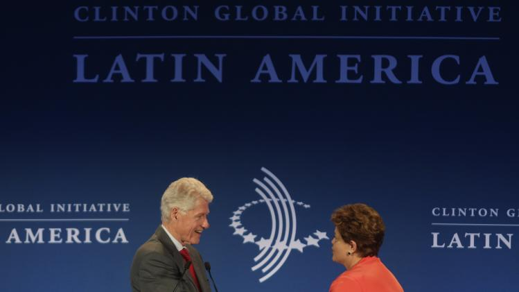 Brazil's President Dilma Rousseff shakes hands with former U.S President Bill Clinton during the Clinton Global Initiative Latin America Meeting in Rio de Janeiro