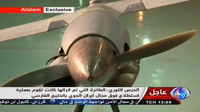 "In this image taken from the Iranian state TV's Arabic-language channel Al-Alam, showed what they purport to be an intact ScanEagle drone aircraft put on display, as an exclusive broadcast Tuesday Dec. 4, 2012, showing what they say are the first pictures of the captured drone.  Iran authorities claimed Tuesday it had captured a U.S. drone after it entered Iranian airspace over the Persian Gulf,  and showing an image of a purportedly downed craft on state TV,  but the U.S. Navy said all its unmanned aircraft in the region were ""fully accounted for.""(AP Photo / Al-Alam TV)  TV OUT"