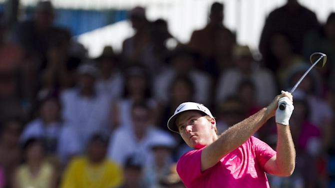 Russell Henley drives off the first tee during the final round of the Sony Open golf tournament, Sunday, Jan. 13, 2013, in Honolulu.  (AP Photo/Marco Garcia)