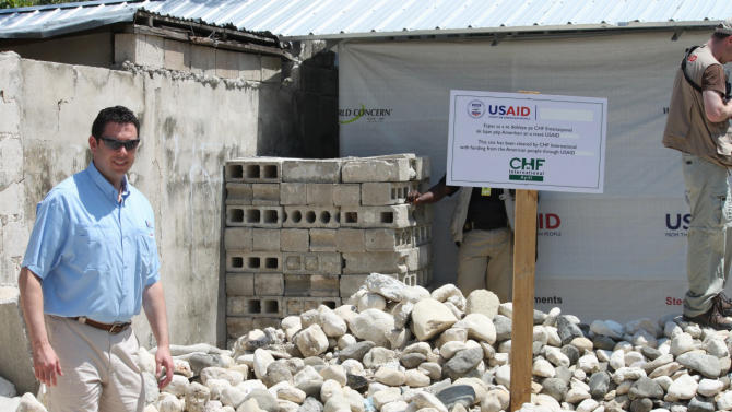 This handout photo provided by Rep. Jason Chaffetz, R-Utah, taken March 29, 2011, shows the congressman at a rubble at a site in Port-au-Prince, Haiti. House Republicans have told the top U.S. foreign aid official that the country's earthquake relief efforts in Haiti have been pathetic. Chaffetz says only 5 percent of the rubble has been removed and 22 percent of the needed transitional shelters have been built. Those figures came from inspector general reports. (AP Photo/Rep. Chaffetz Office)