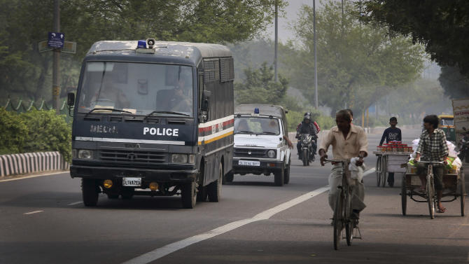 A Delhi state police van believed to be carrying an unknown number of suspects accused of the gang rape and murder of a woman in December, 2012, arrives at the district trial court in New Delhi, India, Monday, March 11, 2013. Indian police confirmed that Ram Singh, one of the men on trial for his alleged involvement in the gang rape and fatal beating of a woman aboard a New Delhi bus committed suicide in an Indian jail Monday, but his lawyer and family allege he was killed. (AP Photo/Manish Swarup)