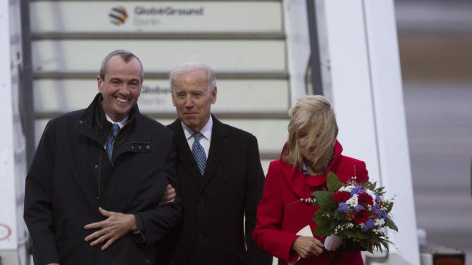 U.S. Vice President Joe Biden, center, accompanied by his wife Jill Biden, right, and U.S. ambassador to Germany Philip D. Murphy, left, walks to his motorcade upon arrival at the Tegel airport in Berlin, Germany, Friday, Feb. 1, 2013. Biden is expected to meet with Chancellor Angela Merkel in Berlin and to attend the annual Munich Security Conference in Munich that starts later Friday. In his meeting with Merkel - his first official visit to Berlin since first taking office in 2009 - Biden is to address international issues, bilateral ties, efforts to seal a free trade deal between Europe and the U.S. and a possible visit by US President Barack Obama to Berlin.(AP Photo/Gero Breloer)