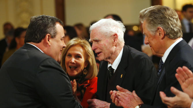 New Jersey Gov. Chris Christie greets former Gov. Brendan Byrne as Byrne's wife Ruthie and former Gov. James Florio, right, after giving details on his 2014 state budget in Trenton, N.J., Tuesday, Feb. 26, 2013. Christie delivered his fourth budget proposal before a joint session of the Legislature at the State House during an election year as the state rebounds from the worst natural disaster in its history. (AP Photo/Rich Schultz)
