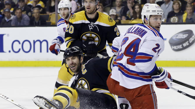 Boston Bruins defenseman Zdeno Chara, front left, goes down against New York Rangers right wing Ryan Callahan (24) as Bruins left wing Daniel Paille (20) looks on during the first period in Game 2 of the NHL Eastern Conference semifinal hockey playoff series in Boston, Sunday, May 19, 2013. (AP Photo/Elise Amendola)