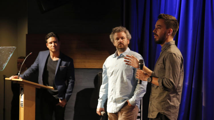 From left, Mario Lopez, Jacob Rosenberg, and Mike Shinoda speak at the Distortion of Sound documentary premiere presented by Harman at the Grammy Museum on Thursday, July 10, 2014, in Los Angeles. (Photo by Todd Williamson/Invision for Harman/AP Images)