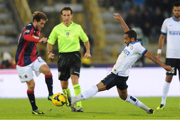 Bologna's Alessandro Diamanti, left, challenges for the ball with Inter's lvaro Pereira during the Italian Serie A soccer match between Bologna and Inter Milan at the Renato Dall' Ara stadium in Bolog