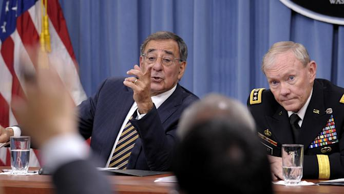 FILE - In this this May 10, 2012, file photo, Defense Secretary Leon Panetta and Joint Chiefs Chairman Gen. Martin E. Dempsey take part in a news conference at the Pentagon in Washington, on the defense budget. Is the U.S. spending enough money on defense, and is it spending it in the right ways? In the aftermath of the 9/11 terrorist attacks the money spigot was turned wide open, pouring hundreds of billions of dollars into the wars in Iraq and Afghanistan and expanding the armed forces. Now that's changing, and an important issue in the election is whether budget cuts have gone too far. (AP Photo/Susan Walsh)