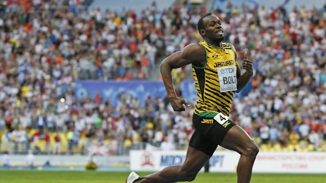 Jamaica's Usain Bolt competes to win the men's 200-meter final at the World Athletics Championships in the Luzhniki stadium in Moscow, Russia, Saturday, Aug. 17, 2013. (AP Photo/Alexander Zemlianichenko)
