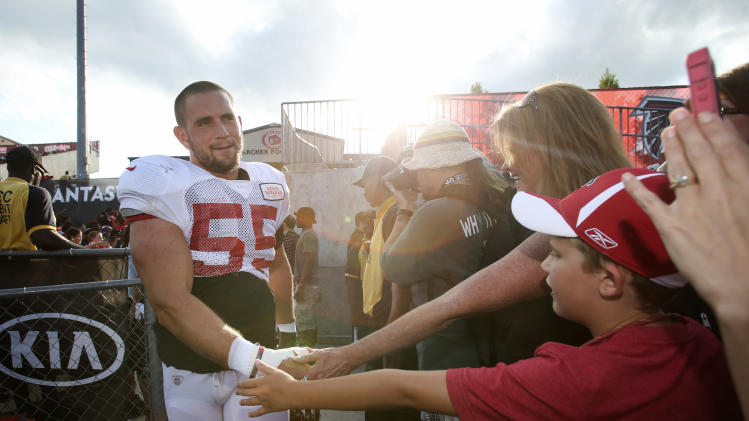 Atlanta Falcons outside linebacker Paul Worrilow (55) greets fans as he walks onto the field during the Falcons' annual Friday Night Lights, at Archer High School on Friday, Aug. 1, 2014, in Lawrenceville, Ga. The Falcons continued their tradition of staging a practice at an area high school each year. (AP Photo/Jason Getz)