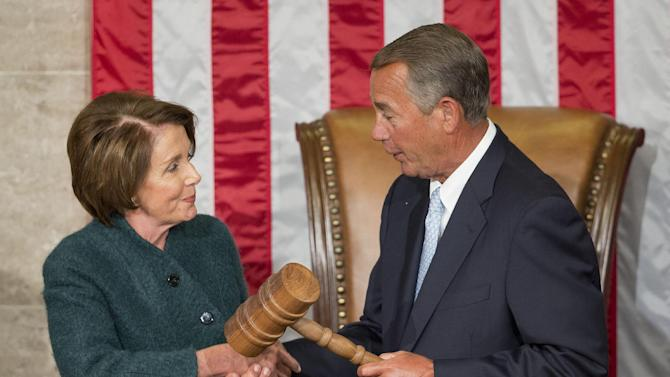 FILE - In this Jan. 6, 2015 file photo, House Speaker John Boehner of Ohio is handed the gavel from House Minority Leader Nancy Pelosi, D-Calif, after being re-elected for a third term to lead the 114th Congress, as Republicans assume full control for the first time in eight years, on Capitol Hill in Washington. Pelosi is bruising some key liberal allies by helping craft a rare bipartisan accord on Medicare. Lawmakers say it will enhance her deal-making status. And it might help her party avoid being sidelined by majority Republicans on future issues.  (AP Photo/Pablo Martinez Monsivais, File)