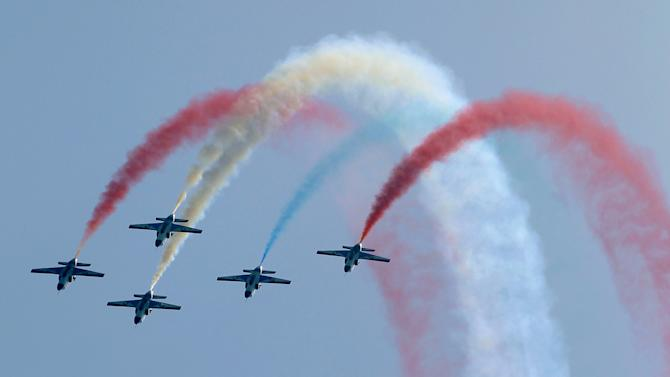 Pakistani Air Force pilots display their skills during rehearsal for the Defence Day ceremony, or Pakistan's Memorial Day in Islamabad
