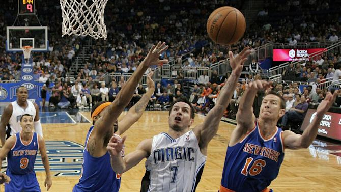 FILE - In this Nov. 13, 2012 file photo,Orlando Magic's J.J. Redick (7) goes up for a shot between New York Knicks' Steve Novak (16) and Rasheed Wallace, left, during the first half of an NBA basketball game in Orlando, Fla. A person familiar with the situation says the Orlando Magic have agreed to trade veteran shooting guard Redick, center Gustavo Ayon and reserve point guard Ish Smith to the Milwaukee Bucks in exchange for guards Doron Lamb and Beno Udrih, as well as forward Tobias Harris. The person spoke to The Associated Press Thursday, Feb. 21, 2013 on condition of anonymity because the deal was not officially complete. (AP Photo/John Raoux, FIle)