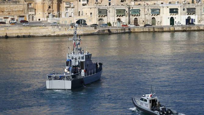 Armed Forces of Malta boats patrol a harbour near Fort St Angelo during the Commonwealth Heads of Government Meeting in Valletta
