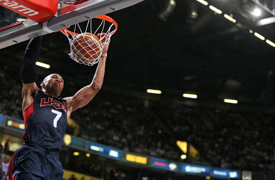 Russell Westbrook of the USA scores during an Olympic Warm Up match at the Manchester Arena, in Manchester, England, Thursday July 19, 2012.  Competitors from around the globe are arriving in London to prepare for the upcoming London 2012 Olympic Games.  (AP Photo / Dave Thompson, PA) UNITED KINGDOM OUT - NO SALES - NO ARCHIVES