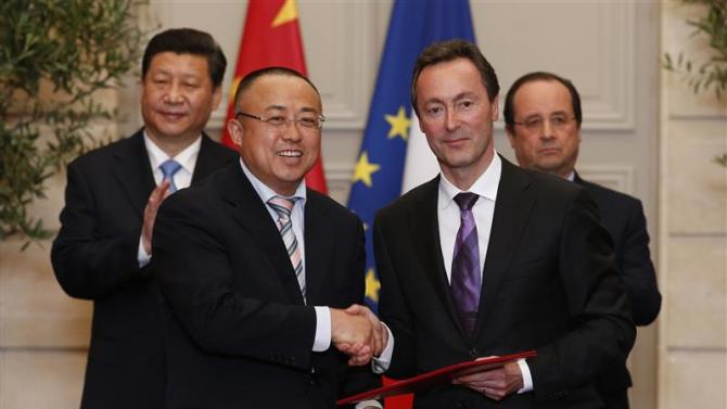 Fabrice Bregier, Airbus President and CEO, and Li Hai, President of CASC shake hands at a signing ceremony at the Elysee Palace in Paris