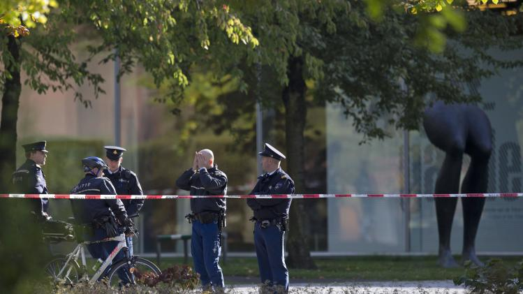 """Police officers guard a cordoned off area at the rear side of the Kunsthal museum in Rotterdam, Tuesday Oct. 16, 2012.  Several paintings have been stolen from a museum in the Dutch city of Rotterdam that was exhibiting works by Pablo Picasso, Henri Matisse and Vincent van Gogh.  At least several paintings were stolen early Tuesday morning from the Kunsthal museum , but their names have not yet been released. They are believed to include at least one by Henri Matisse, the 1919 """"Reading Girl.""""  (AP Photo/Peter Dejong)"""