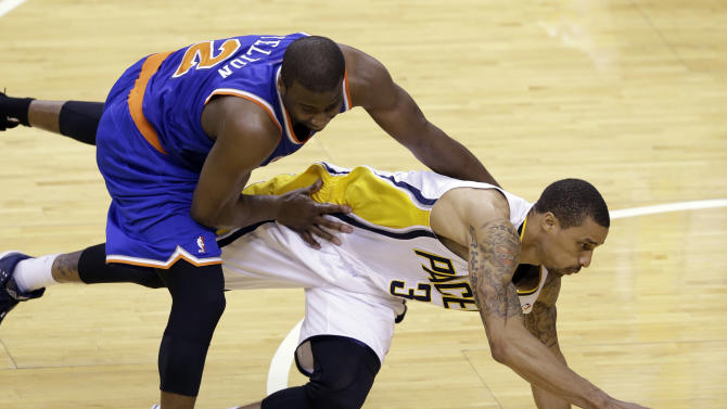 New York Knicks guard Raymond Felton, left, fouls Indiana Pacers guard George Hill during the second half of Game 4 of the Eastern Conference semifinal NBA basketball playoff series, in Indianapolis on Tuesday, May 14, 2013. (AP Photo/Michael Conroy)