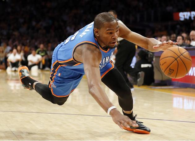 Oklahoma City Thunder forward Kevin Durant reaches for a loose ball against the Los Angeles Lakers during the second half of an NBA basketball game in Los Angeles, Sunday, March 9, 2014. The Lakers wo